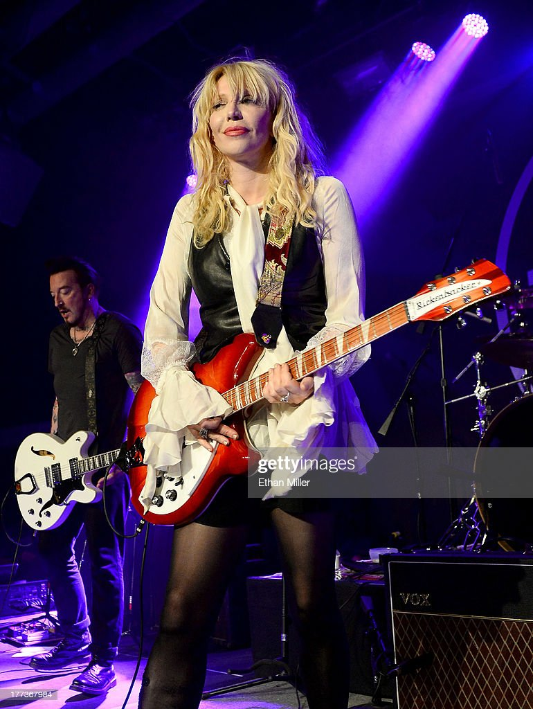 Recording artist <a gi-track='captionPersonalityLinkClicked' href=/galleries/search?phrase=Courtney+Love&family=editorial&specificpeople=156418 ng-click='$event.stopPropagation()'>Courtney Love</a> performs at Vinyl inside the Hard Rock Hotel & Casino during the venue's anniversary celebration on August 22, 2013 in Las Vegas, Nevada.