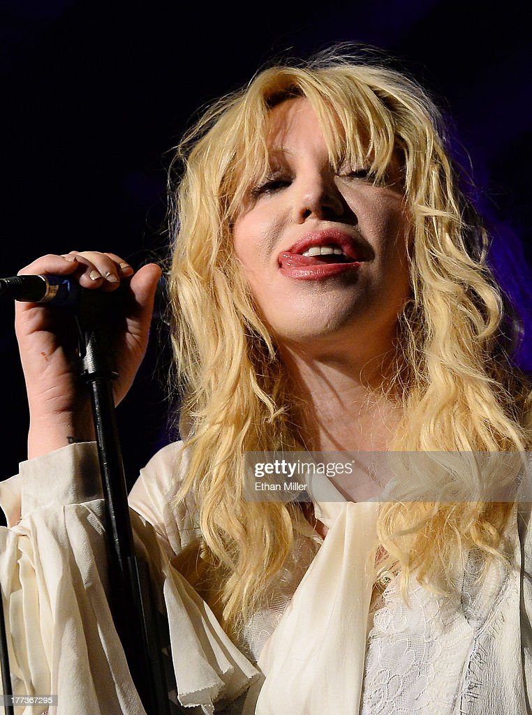 Recording artist <a gi-track='captionPersonalityLinkClicked' href=/galleries/search?phrase=Courtney+Love&family=editorial&specificpeople=156418 ng-click='$event.stopPropagation()'>Courtney Love</a> sticks her tongue out as she performs at Vinyl inside the Hard Rock Hotel & Casino during the venue's anniversary celebration on August 22, 2013 in Las Vegas, Nevada.