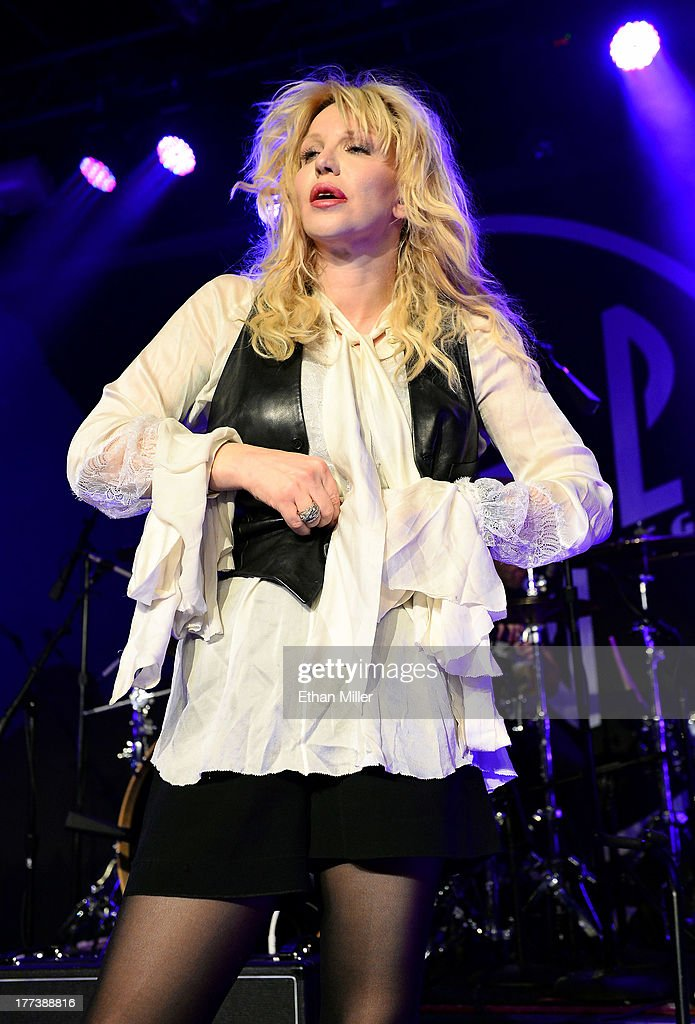 Recording artist <a gi-track='captionPersonalityLinkClicked' href=/galleries/search?phrase=Courtney+Love&family=editorial&specificpeople=156418 ng-click='$event.stopPropagation()'>Courtney Love</a> takes off her vest as she performs at Vinyl inside the Hard Rock Hotel & Casino during the venue's anniversary celebration on August 22, 2013 in Las Vegas, Nevada.
