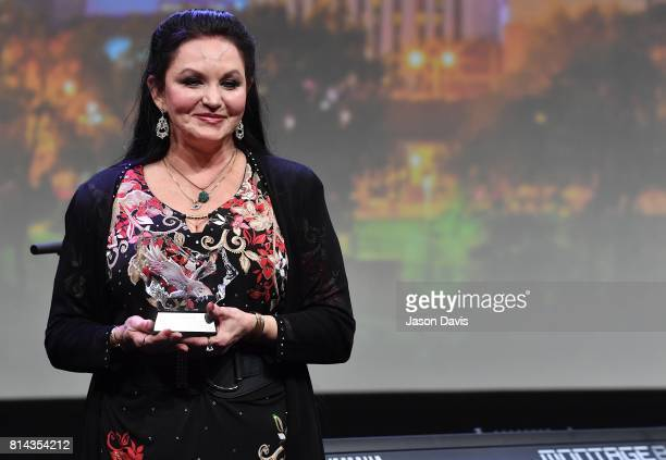 Recording Artist Crystal Gayle speaks during the American Eagle Awards Honoring Crystal Gayle Patti Smith and Harry Shearer at Music City Center on...