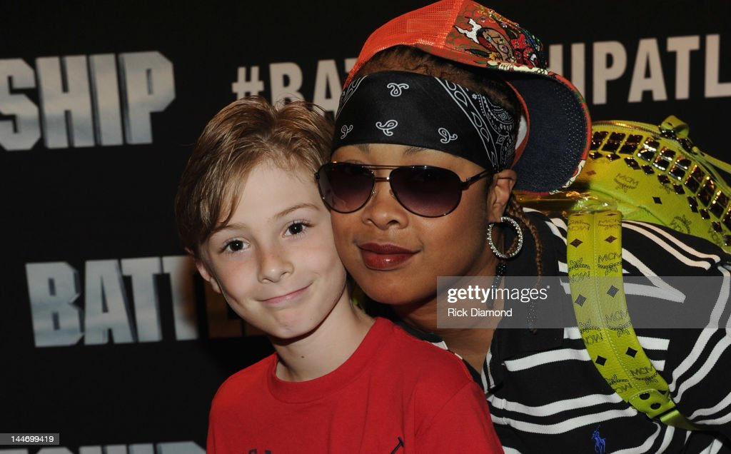 Recording Artist <a gi-track='captionPersonalityLinkClicked' href=/galleries/search?phrase=Da+Brat&family=editorial&specificpeople=594020 ng-click='$event.stopPropagation()'>Da Brat</a> (right) and Godson Kclifton attend V-103 Private Atlanta BATTLESHIP Screening at AMC Phipps Plaza on May 17, 2012 in Atlanta, Georgia.