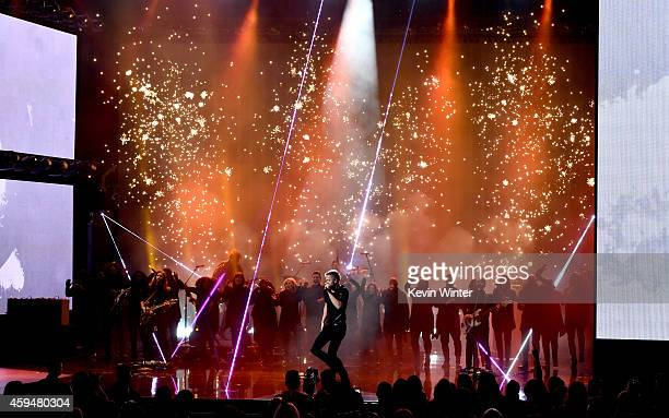 Recording artist Dan Reynolds of music group Imagine Dragons performs onstage at the 2014 American Music Awards at Nokia Theatre LA Live on November...