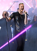 Recording artist Dan Reynolds of music group Imagine Dragons performs onstage during the 2014 American Music Awards held at Nokia Theatre LA Live on...