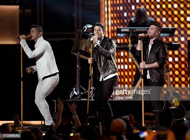Recording artist Dan Smyers of Dan Shay singer/actor Nick Jonas and recording artist Shay Mooney of Dan Shay perform onstage during the 50th Academy...