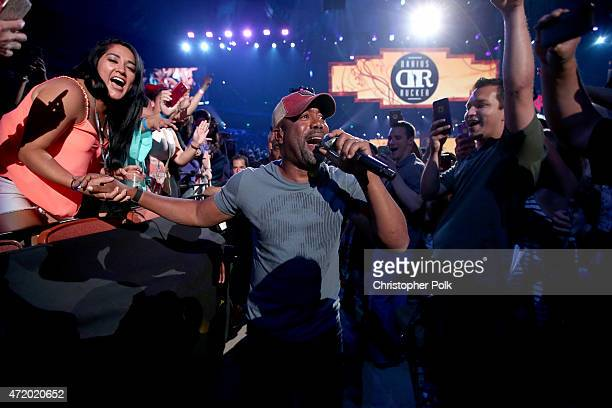 Recording artist Darius Rucker performs in the audience during the 2015 iHeartRadio Country Festival at The Frank Erwin Center on May 2 2015 in...