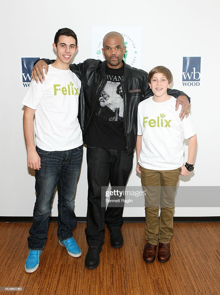 Recording artist <a gi-track='captionPersonalityLinkClicked' href=/galleries/search?phrase=Darryl+McDaniels&family=editorial&specificpeople=175934 ng-click='$event.stopPropagation()'>Darryl McDaniels</a> poses for a picture with guest during the 'Dance This Way' Benefit Dance-A-Thon kick off party at WB Wood on February 28, 2013 in New York City.