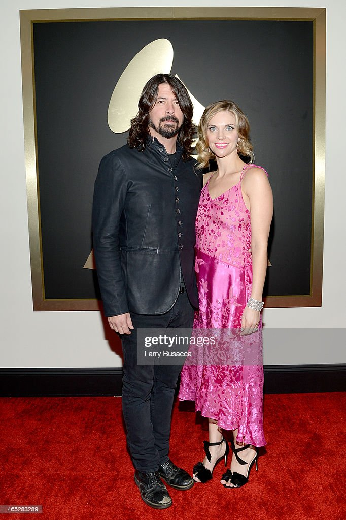 Recording artist Dave Grohl and wife Jordyn Blum attend the 56th GRAMMY Awards at Staples Center on January 26, 2014 in Los Angeles, California.