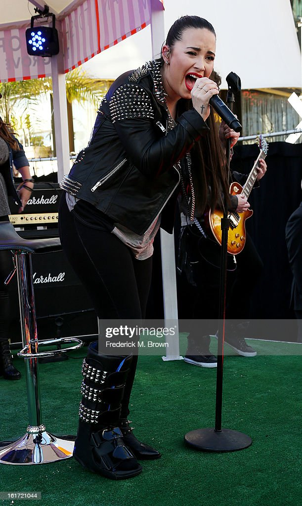 Recording artist <a gi-track='captionPersonalityLinkClicked' href=/galleries/search?phrase=Demi+Lovato&family=editorial&specificpeople=4897002 ng-click='$event.stopPropagation()'>Demi Lovato</a> performs during Topshop Topman LA Grand Opening at The Grove on February 14, 2013 in Los Angeles, California.