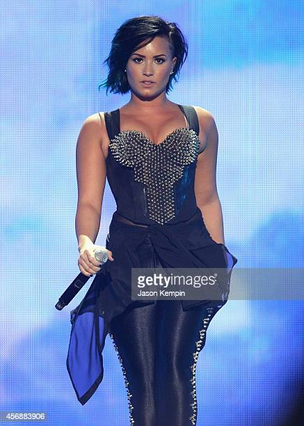 Recording artist Demi Lovato performs onstage during the Vevo CERTIFIED SuperFanFest presented by Honda Stage at Barkar Hangar on October 8 2014 in...