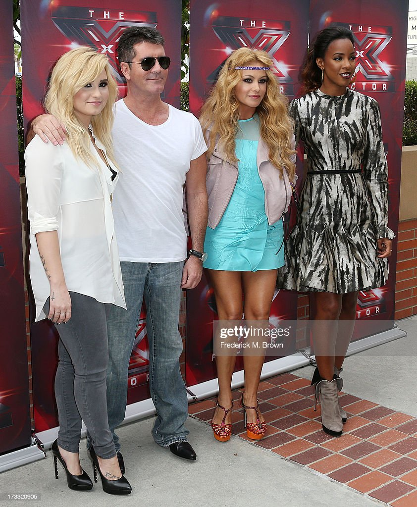 Recording artist Demi Lovato, producer Simon Cowell, recording artists Paulina Rubio and Kelly Rowland attend Fox's 'The X Factor' Judges at the Galen Center on July 11, 2013 in Los Angeles, California.
