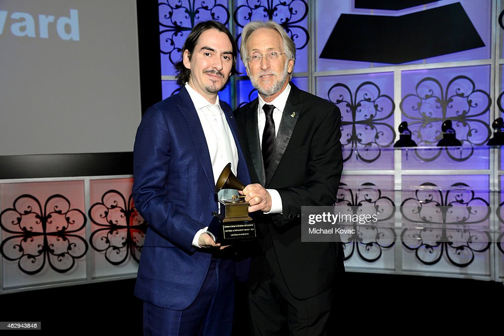 Recording artist Dhani Harrison (L) and President/CEO of The Recording Academy and GRAMMY Foundation President/CEO Neil Portnow attend The 57th Annual GRAMMY Awards - Special Merit Awards Ceremony on February 7, 2015 in Los Angeles, California.