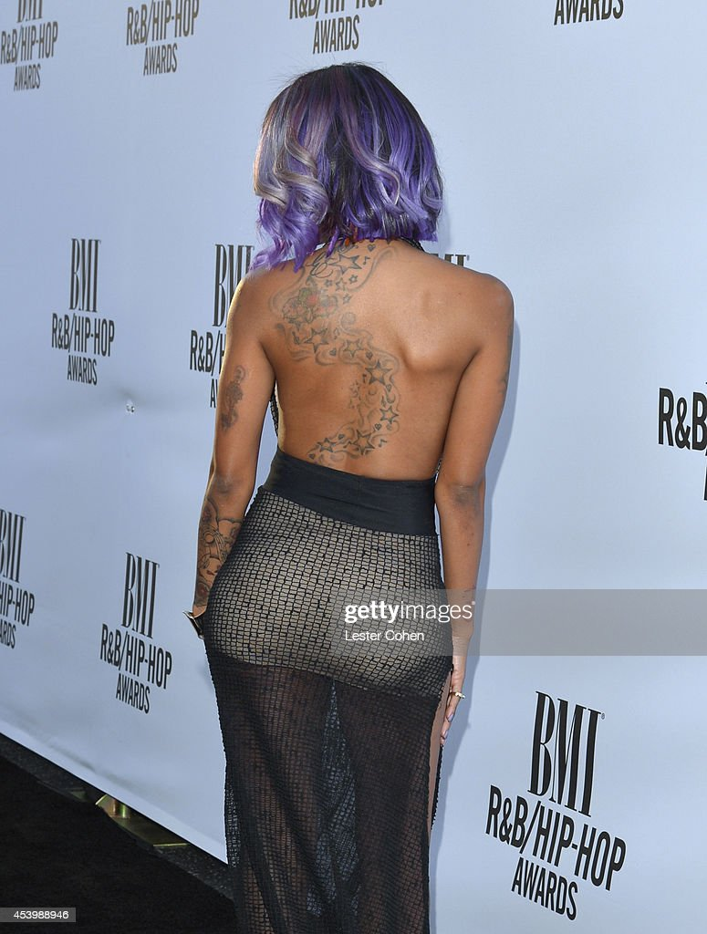 Recording artist Diamond (fashion, tattoo, and dress details) attends the 2014 BMI R&B/Hip-Hop Awards at the Pantages Theatre on August 22, 2014 in Hollywood, California.