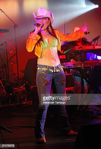 Recording artist Diana Reyes performs for the Billboard Bash party at the Ritz Carlton South Beach on April 26 2006 in Miami Beach Florida