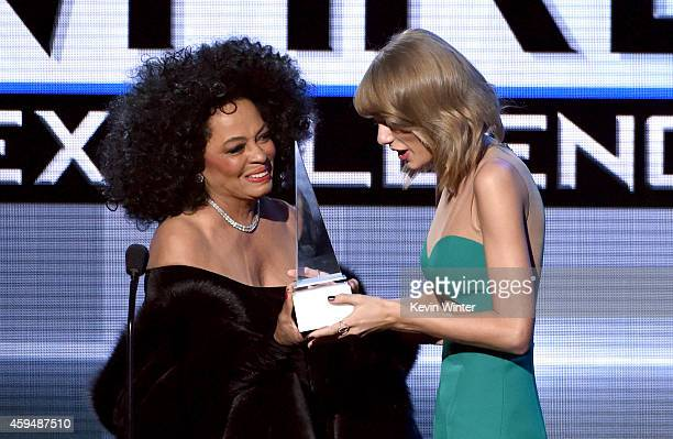 Recording artist Diana Ross presents the Dick Clark Award for Excellence to honoree Taylor Swift onstage at the 2014 American Music Awards at Nokia...