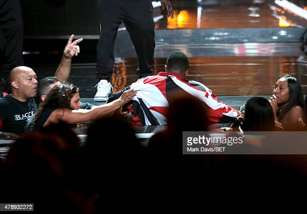 Recording artist Diddy falls during performance onstage during the 2015 BET Awards at the Microsoft Theater on June 28 2015 in Los Angeles California
