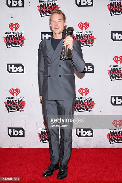 Recording artist Diplo winner of the award for Best Dance Song poses in the press room during the iHeartRadio Music Awards at The Forum on April 3...