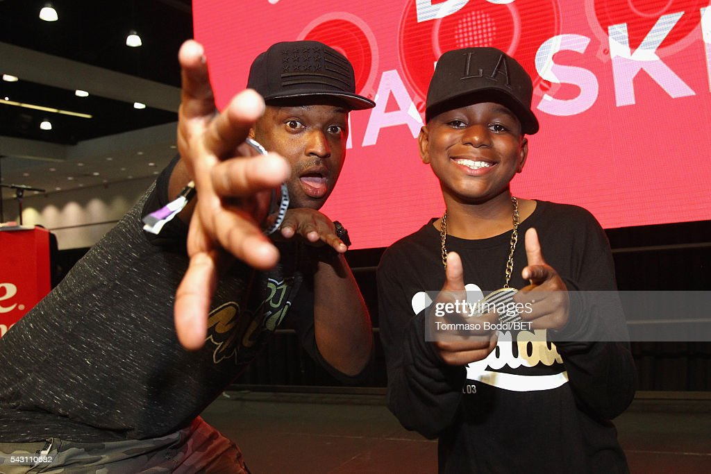 Recording artist DJ Mal-Ski (L) and a fan pose at the Coke music studio during the 2016 BET Experience on June 25, 2016 in Los Angeles, California.