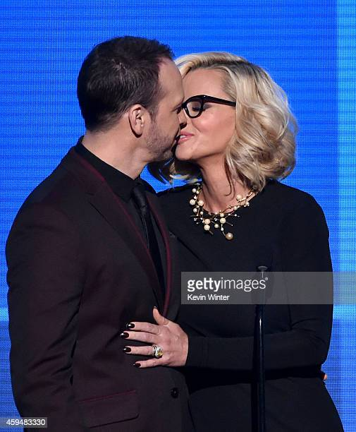 Recording artist Donnie Wahlberg and TV personality Jenny McCarthy speak onstage at the 2014 American Music Awards at Nokia Theatre LA Live on...