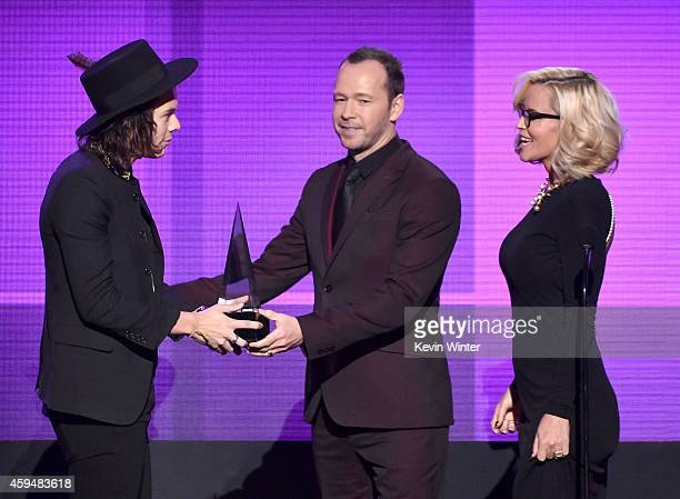 Recording artist Donnie Wahlberg and TV personality Jenny McCarthy present recording artist Harry Styles of One Direction with the Favorite Pop/Rock...