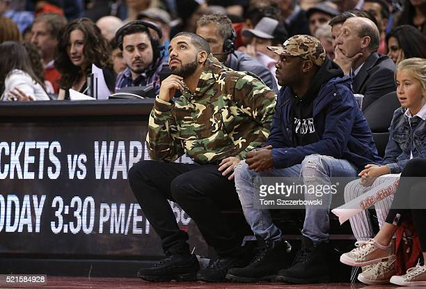 Recording artist Drake and team ambassador of the Toronto Raptors looks on in the late stages of the game against the Indiana Pacers in Game One of...