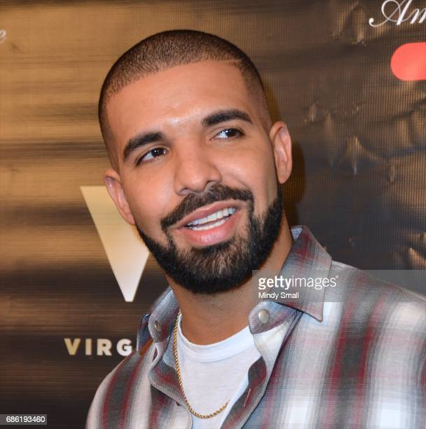 Recording artist Drake arrives at Sugar Factory American Brasserie at the Fashion Show mall to debut his signature Night Owl goblet for his Virginia...