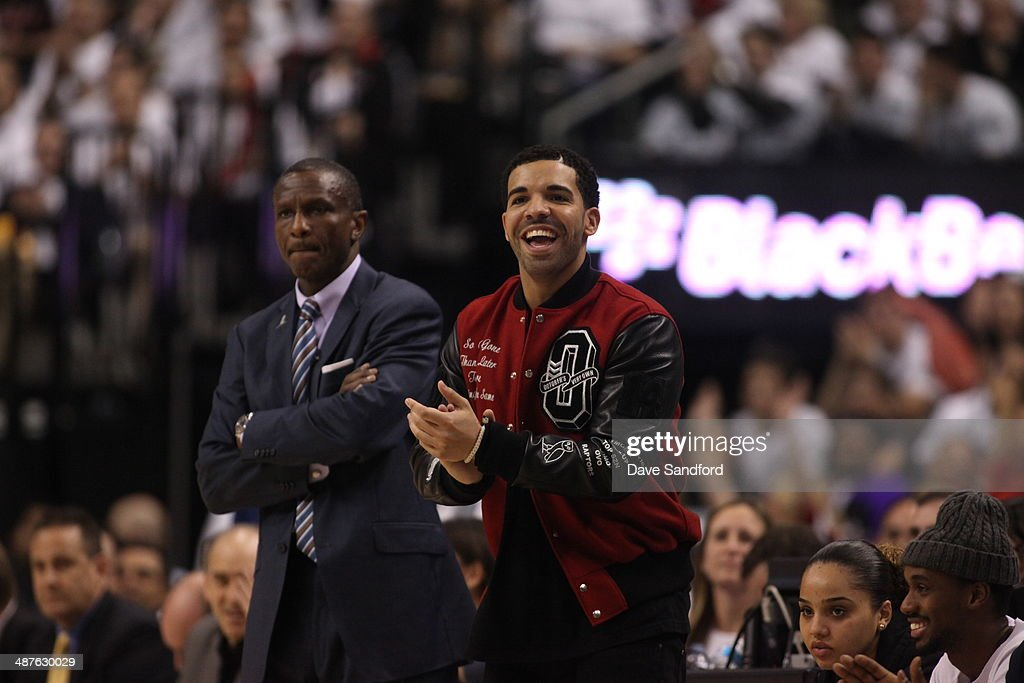 Recording artist, Drake cheers for the Toronto Raptors during Game five of the Quarterfinal NBA Eastern Conference playoff game against the Brooklyn Nets at the Air Canada Centre on April 30, 2014 in Toronto, Ontario, Canada.