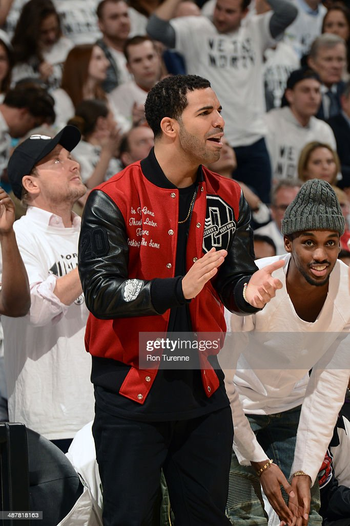 Recording Artist, <a gi-track='captionPersonalityLinkClicked' href=/galleries/search?phrase=Drake+-+Entertainer&family=editorial&specificpeople=6927008 ng-click='$event.stopPropagation()'>Drake</a> cheers for the Toronto Raptors during Game Five of the Eastern Conference Quarterfinals against the Brooklyn Nets during the 2014 NBA Playoffs on April 30, 2014 at the Air Canada Centre in Toronto, Ontario, Canada.