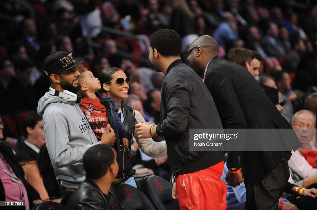 Recording artist Drake greets fellow artists Swizz Beatz and Alicia Keys during 2013 Taco Bell Skills Challenge on State Farm All-Star Saturday Night as part of 2013 NBA All-Star Weekend on February 16, 2013 at Toyota Center in Houston, Texas.