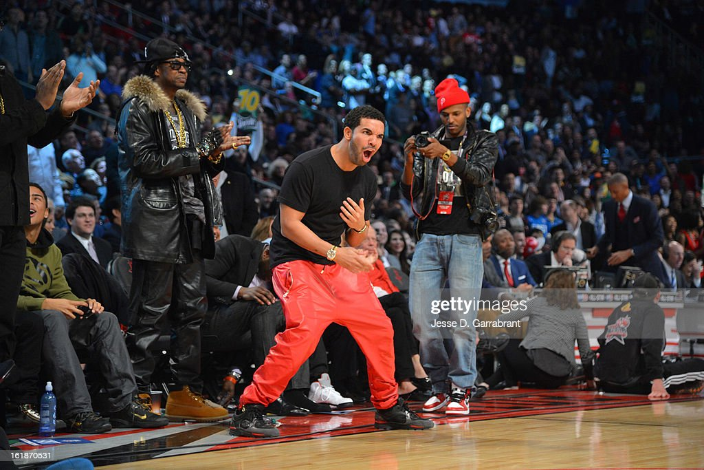 Recording artist Drake jumps out of his courtside seat during the 2013 Sprite Slam Dunk Contest on State Farm All-Star Saturday Night as part of the 2013 NBA All-Star Weekend on February 16, 2013 at the Toyota Center in Houston, Texas.