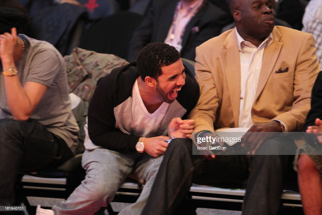Recording Artist Drake smiles as he watches the game from courtside during 2013 NBA All-Star Game on February 17, 2013 at Toyota Center in Houston, Texas.