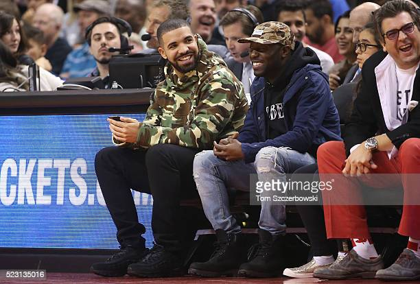 Recording artist Drake watches the Toronto Raptors game against the Indiana Pacers in Game One of the Eastern Conference Quarterfinals during the...
