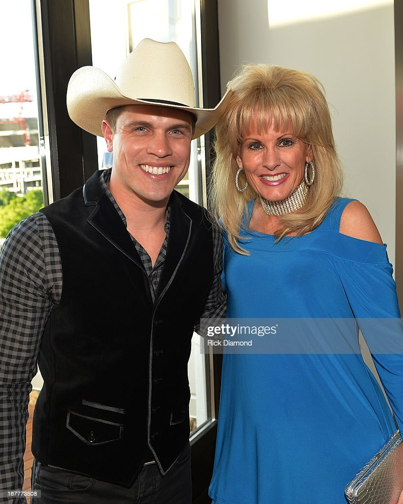 Recording Artist Dustin Lynch and Laura Heatherly, Chief Executive Officer of T.J. Martell nationwide organization attend the 14th annual T.J. Martell Foundation Nashville Best Cellars dinner at the Bridge Building on April 29, 2013 in Nashville, Tennessee.