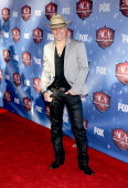Recording artist Dustin Lynch arrives at the American Country Awards 2013 at the Mandalay Bay Events Center on December 10 2013 in Las Vegas Nevada