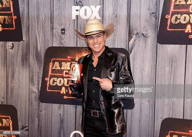 Recording artist Dustin Lynch attends the 2014 American Country Countdown Awards at Music City Center on December 15 2014 in Nashville Tennessee