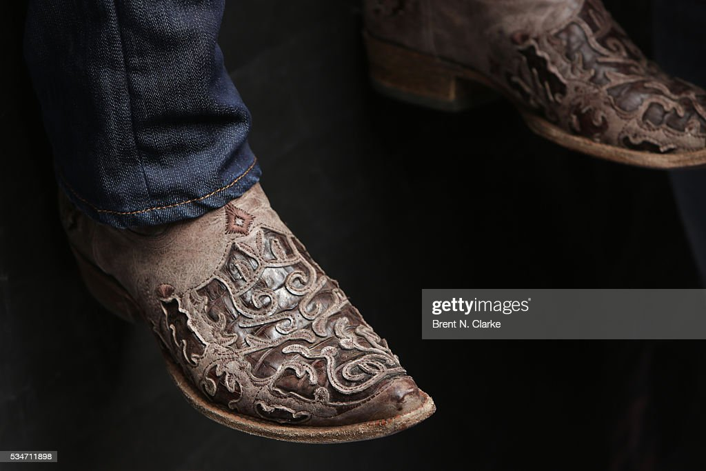 Recording artist <a gi-track='captionPersonalityLinkClicked' href=/galleries/search?phrase=Dustin+Lynch&family=editorial&specificpeople=8612719 ng-click='$event.stopPropagation()'>Dustin Lynch</a>, boot detail, performs on stage during the 'FOX & Friends' All American Concert Series outside of FOX Studios on May 27, 2016 in New York City.