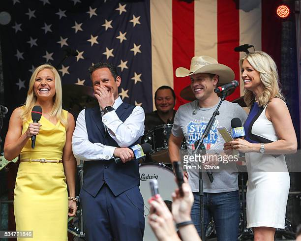 Recording artist Dustin Lynch is seen on stage with 'FOX Friends' cohosts Anna Kooiman Brian Kilmeade and Ainsley Earhardt during the 'FOX Friends'...