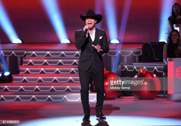 Recording artist Dustin Lynch performs during CMA 2017 Country Christmas at The Grand Ole Opry on November 14 2017 in Nashville Tennessee