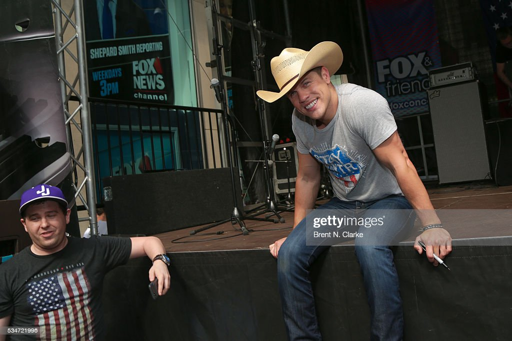 Recording artist <a gi-track='captionPersonalityLinkClicked' href=/galleries/search?phrase=Dustin+Lynch&family=editorial&specificpeople=8612719 ng-click='$event.stopPropagation()'>Dustin Lynch</a> poses for photographs following his performance on the 'FOX & Friends' All American Concert Series outside of FOX Studios on May 27, 2016 in New York City.
