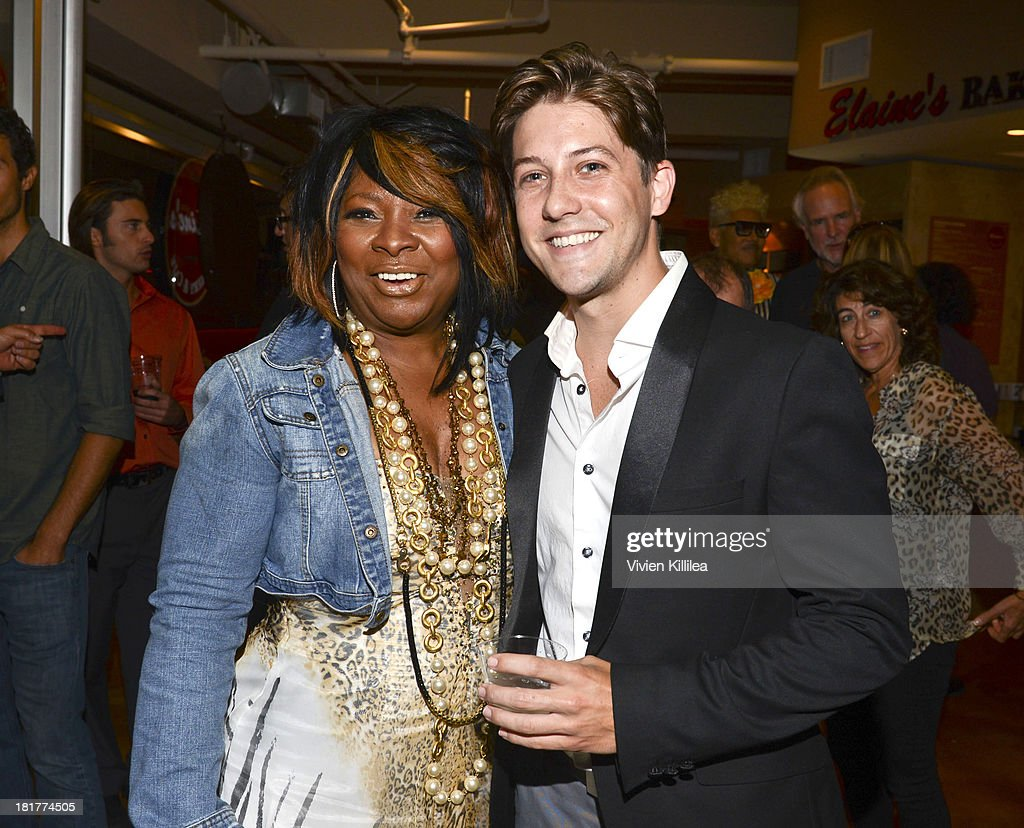 Recording artist Elaine Gibbs and actor Drew Cash attend Elaine's Bakery And Cafe Celebrates Grand Opening At Brentwood Gardens on September 24, 2013 in Los Angeles, California.