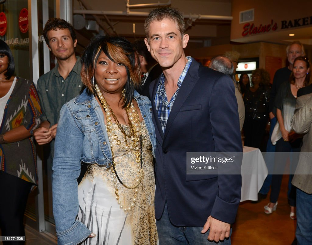 Recording artist Elaine Gibbs and Eric Charles Jorgenson attend Elaine's Bakery And Cafe Celebrates Grand Opening At Brentwood Gardens on September 24, 2013 in Los Angeles, California.