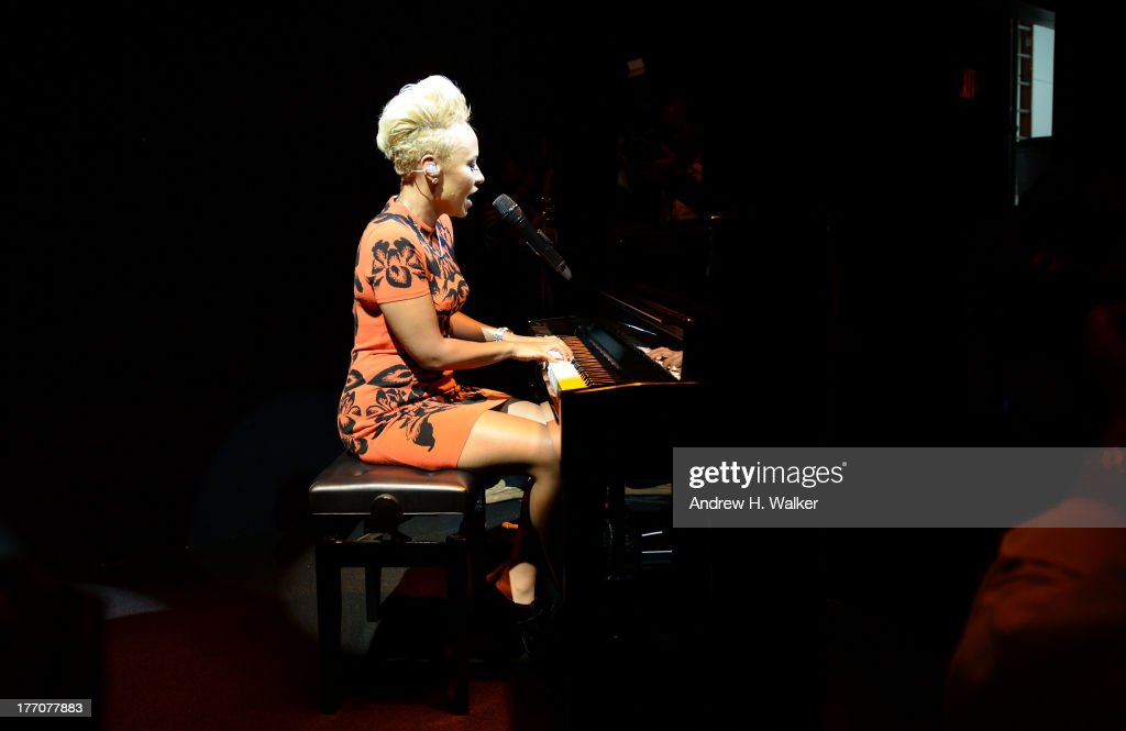 Recording artist <a gi-track='captionPersonalityLinkClicked' href=/galleries/search?phrase=Emeli+Sande&family=editorial&specificpeople=7220317 ng-click='$event.stopPropagation()'>Emeli Sande</a> performs onstage at Moet & Chandon Celebrates Its 270th Anniversary With New Global Brand Ambassador, International Tennis Champion, Roger Federer at Chelsea Piers Sports Center on August 20, 2013 in New York City.