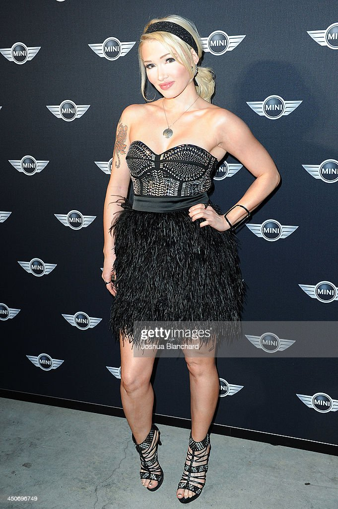 Recording artist Emii arrives at Kim Sing Theatre for MINI Cooper Unveils Newest Addition To The MINI Fleet During Los Angeles Auto Show on November 19, 2013 in Los Angeles, California.