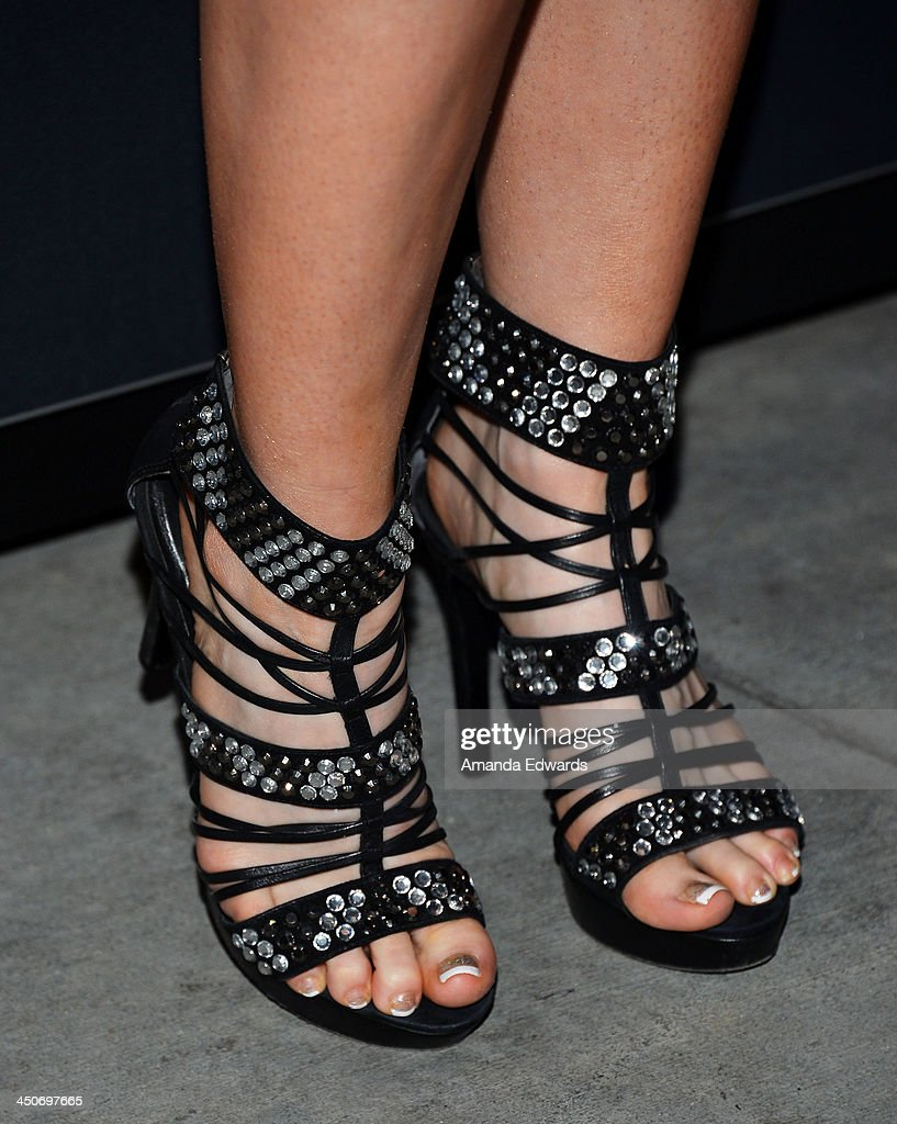 Recording artist Emii (shoe detail) arrives at the MINI Cooper red carpet premiere on November 19, 2013 in Los Angeles, California.