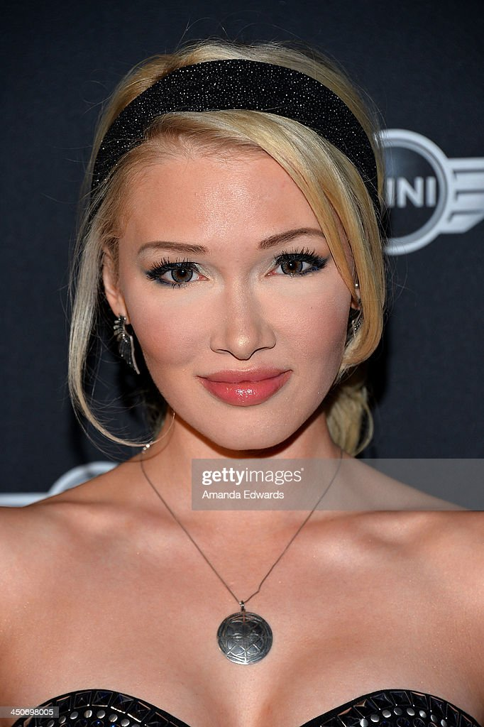Recording artist Emii arrives at the MINI Cooper red carpet premiere on November 19, 2013 in Los Angeles, California.