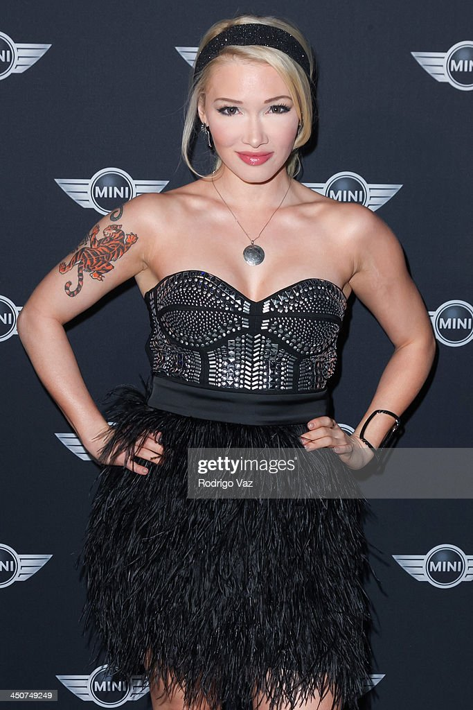 Recording artist Emii attends as MINI Cooper unveils newest addition to the MINI fleet during Los Angeles Auto Show at Kim Sing Theatre on November 19, 2013 in Los Angeles, California.