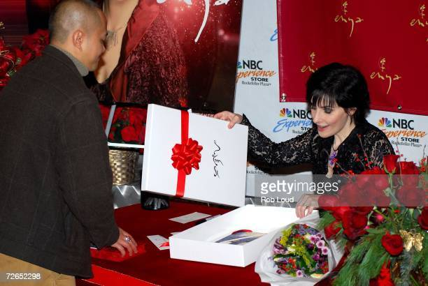 Recording artist Enya receives a gift from a fan at her holiday CD signing at the NBC Experience Store on November 27 2006 in New York City