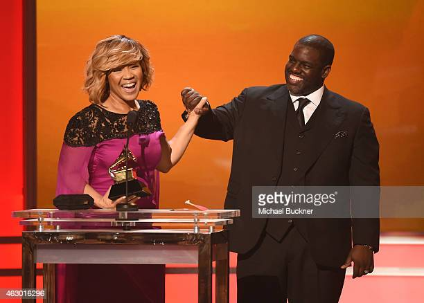 Recording artist Erica Campbell and record producer Warryn Campbell accept the award Best Gospel Album onstage at the Premiere Ceremony during The...