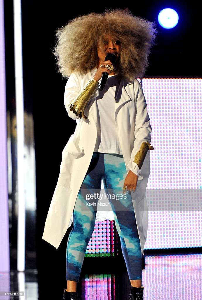 Recording artist <a gi-track='captionPersonalityLinkClicked' href=/galleries/search?phrase=Erykah+Badu&family=editorial&specificpeople=224744 ng-click='$event.stopPropagation()'>Erykah Badu</a> onstage during the 2013 BET Awards at Nokia Theatre L.A. Live on June 30, 2013 in Los Angeles, California.