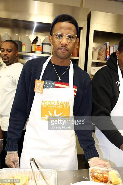 Recording artist Fabolous visits the Food Bank for New York City's Community Kitchen of West Harlem on December 23 in New York City