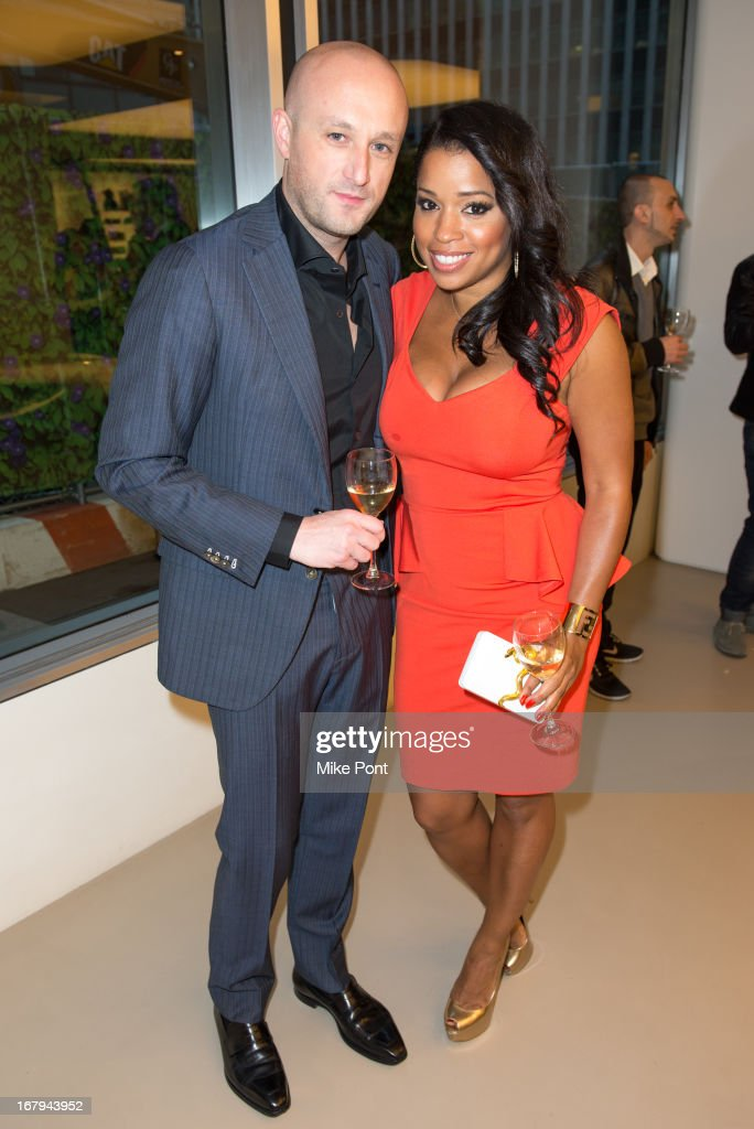 Recording Artist Fabrizio Sotti and <a gi-track='captionPersonalityLinkClicked' href=/galleries/search?phrase=Mashonda&family=editorial&specificpeople=673897 ng-click='$event.stopPropagation()'>Mashonda</a> attend Fabrizio Sotti's 'Right Now' Album Listening Party at the Ferrari Corporate Showroom Of New York on May 2, 2013 in New York City.